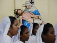 Indian Roman Catholic nuns of the Missionaries of Charity order attend a mass to announce St. Teresa of Calcutta a 'co-patron' of the archdiocese at the Cathedral of the Most Holy Rosary in Kolkata on September 6, 2017. Pope Francis on September 4, 2016 proclaimed Mother Teresa a saint, hailing …