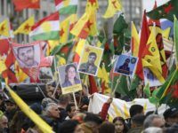 Kurdish protesters wave their national flags and hold photos of Kurdish political leader killed last week Hevrin Kahlaf, during a pro-Kurdish demonstration in Cologne, western Germany on October 19, 2019. (Photo by Ina Fassbender / AFP) (Photo by INA FASSBENDER/AFP via Getty Images)