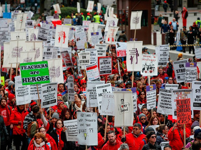 Teachers and supporters gather for the rally on the first day of strike by the Chicago Teachers Union on October 17, 2019 in Chicago, Illinois. (Photo by KAMIL KRZACZYNSKI / AFP) (Photo by KAMIL KRZACZYNSKI/AFP via Getty Images)