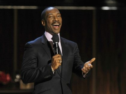"""Eddie Murphy addresses the audience at the close of """"Eddie Murphy: One Night Only,"""" a celebration of Murphy's career at the Saban Theater on Saturday, Nov. 3, 2012, in Beverly Hills, Calif. (Photo by Chris Pizzello/Invision)"""