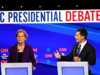 WESTERVILLE, OHIO - OCTOBER 15: Sen. Elizabeth Warren (D-MA) listens to South Bend, Indiana Mayor Pete Buttigieg during the Democratic Presidential Debate at Otterbein University on October 15, 2019 in Westerville, Ohio. A record 12 presidential hopefuls are participating in the debate hosted by CNN and The New York Times. …