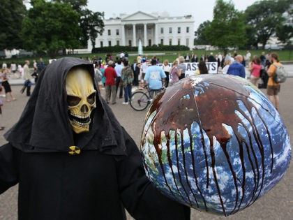 WASHINGTON - JUNE 16: A protester dressed as the grim reaper holds a globe during a protest in front of the White House on June 16, 2010 in Washington, DC. Several activist groups protested BPs response to the oil spill in the Gulf of Mexico. (Photo by Mark Wilson/Getty Images)