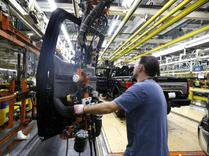DEARBORN, MI - SEPTEMBER 27: A Ford Motor Company workers works on a Ford F150 truck on the assembly line at the Ford Dearborn Truck Plant on September 27, 2018 in Dearborn, Michigan. The Ford Rouge Plant is celebrating 100 years as America's longest continuously operating auto plant. The factory …