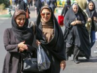 Iranian women walk in Sadeqyeh Square in the capital Tehran on October 8, 2019. - After a ban spanning decades, Iranian women are set to freely enter a football stadium for the first time on October 10 as Iran hosts Cambodia in a World Cup 2022 qualifier at Tehran's Azadi …