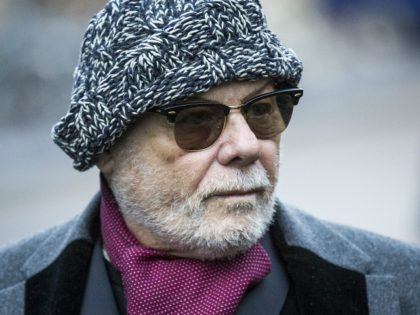 LONDON, ENGLAND - JANUARY 13: Gary Glitter, real name Paul Gadd, arrives at Southwark Crown Court on January 13, 2015 in London, England. The former glam rock star is charged with several historic sex offences against young girls. (Photo by Rob Stothard/Getty Images)