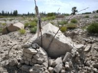 This photo taken on September 12, 2019 shows what used to be a traditional Uighur cemetery before it was destroyed in Shayar in the region of Xinjiang. - China is destroying burial grounds where generations of Uighur families have been laid to rest, leaving behind human bones and broken tombs …