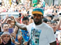 NBA star LeBron James poses with his fans during a promotional event at a shopping district in Hong Kong as part of his China tour Wednesday, July 23, 2014. Earlier this month, James left the Miami Heat after four seasons and four trips to the NBA Finals and re-signed with …