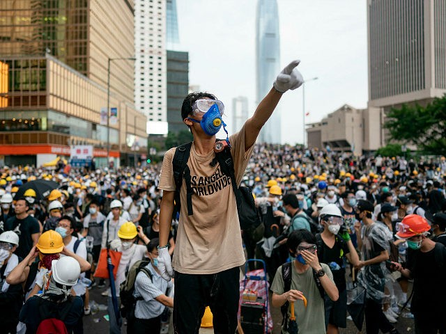 HONG KONG, HONG KONG - JUNE 12: A protester makes a gesture during a protest on June 12, 2019 in Hong Kong China. Large crowds of protesters gathered in central Hong Kong as the city braced for another mass rally in a show of strength against the government over a …