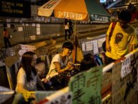 HONG KONG - OCTOBER 09: Pro-democracy activists eat dinner in the streets outside Hong Kong's Government complex on October 9, 2014 in Hong Kong, Hong Kong. Friday's scheduled talks between pro-democracy activists and government officials was cancelled by the government after student leaders called for a show of strength at …