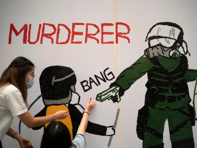 Protestors make a mural depicting a teenage demonstrator shot at close range in the chest by a police officer, in Hong Kong, Wednesday, Oct. 2, 2019. The shooting Tuesday during widespread anti-government demonstrations on China's National Day was a fearsome escalation in Hong Kong's protest violence. The 18-year-old is the …