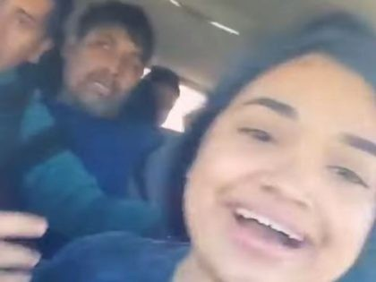 Facebook Live video shows alleged human smuggler in SUV packed with migrants.