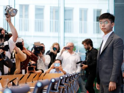 Prominent Hong Kong activist Joshua Wong faces photographers before holding a press conference, on September 11, 2019 in Berlin. - Joshua Wong had met Germany's Foreign minister the day before as he carried abroad his call to support the growing pro-democracy movement in the former British colony, a meeting slammed …