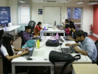 Employees work on their computers at the office of HackerEarth in Bangalore, India, Wednesday, Oct. 14, 2015. (AP Photo/Altaf Qadri)