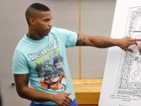 In this Tuesday, Sept. 24, 2019, photo, victim Botham Jean's neighbor Joshua Brown, left, answers questions from Assistant District Attorney LaQuita Long, right, while pointing to a map of the South Side Flats where he lives, while testifying during the murder trial of former Dallas Police Officer Amber Guyger, in …