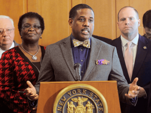 In this Feb. 6, 2017, file photo, Sen. Kevin Parker, D- Brooklyn, stands at the podium, flanked by Senate members during a news conference at the Capitol in Albany, N.Y. Parker wants to require police to scrutinize social media activity and online searches of handgun license applicants, and disqualify those …