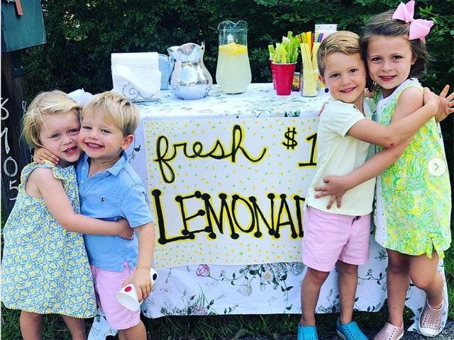 Viral Photo of Kids' Lemonade Stand Raises over $125K for Children's Hospital