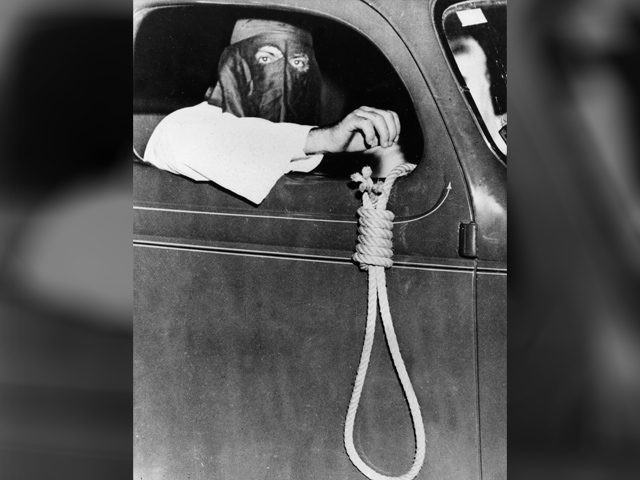 A hangman's noose dangling from an automobile driven by a hooded Ku Klux Klan member is among the grim warnings to blacks to stay away from the voting places in the municipal primary election at Miami, Fla., on May 3, 1939. In spite of the threats, 616 blacks exercised their …