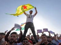 Kurds take part in a demonstration in Arbil, the capital of the northern Iraqi Kurdish autonomous region, on October 10, 2019 against the Turkish offensive in northeastern Syria. - Syria's Kurds battled to hold off a Turkish invasion on October 9 after air strikes and shelling launched a long-threatened operation …