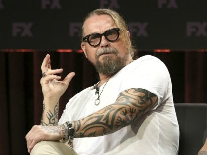"""Kurt Sutter, co-creator/executive producer/writer, participates in the """"Mayans M.C."""" panel during the FX Television Critics Association Summer Press Tour at The Beverly Hilton hotel on Friday, Aug. 3, 2018, in Beverly Hills, Calif. (Photo by Willy Sanjuan/Invision/AP)"""