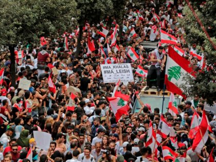 Lebanese protesters rally in downtown Beirut on the third day of demonstrations against tax increases and official corruption, on October 20, 2019. - Tens of thousands of people took to the streets for a third day of protests against tax increases and alleged official corruption. The protesters took to the …