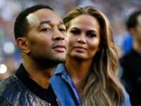 GLENDALE, AZ - FEBRUARY 01: Musician John Legend and model Chrissy Teigen look on prior to Super Bowl XLIX between Seattle Seahawks and New England Patriots at University of Phoenix Stadium on February 1, 2015 in Glendale, Arizona. (Photo by Kevin C. Cox/Getty Images)