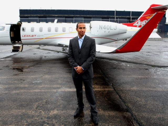 British Formula One Racing Driver Lewis Hamilton with his Bombardier Lear Jet at the Bombardier Aerospace factory where he met with workers in East Belfast, Northern Ireland, Friday, Jan. 18, 2008. Bombardier Aerospace, Belfast have launched a year of celebrations to mark a century of aviation heritage. Founded in November …