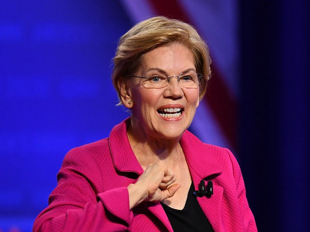 Democratic presidential hopeful Massachusetts Senator Elizabeth Warren gestures as she arrives for a town hall devoted to LGBTQ issues hosted by CNN and the Human rights Campaign Foundation at The Novo in Los Angeles on October 10, 2019. (Photo by Robyn Beck / AFP) (Photo by ROBYN BECK/AFP via Getty …