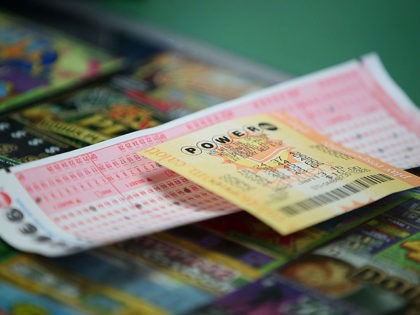 SAN LORENZO, CA - JANUARY 13: A Powerball ticket sits on the counter at Kavanagh Liquors on January 13, 2016 in San Lorenzo, California. Dozens of people lined up outside of Kavanagh Liquors, a store that has had several multi-million dollar winners, to -purchase Powerball tickets in hopes of winning …