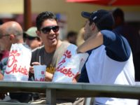 Two men prepare to have lunch on the patio of the Chick-fil-A in Hollywood, California, August 1, 2012. Thousands of Americans turned out Wednesday to feast on fried chicken in a politically-charged show of support for a family owned fast-food chain which opposes same-sex marriage. Long lines and traffic jams …