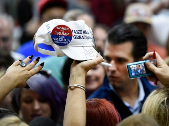 LAS VEGAS, NV - NOVEMBER 03: A women raises a ball cap in support for Republican presidential nominee Donald Trump to be signed by his son, Donald Trump Jr. at a get-out-the-vote rally at Ahern Manufacturing on November 3, 2016 in Las Vegas, Nevada. Trump Jr. urged people to vote …