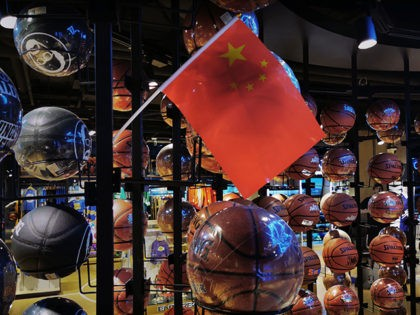 BEIJING, CHINA - OCTOBER 09: (IMAGE TAKEN WITH MOBILE PHONE CAMERA) A Chinese flag is seen placed on basketballs in the NBA flagship retail store on October 9, 2019 in Beijing, China. The NBA is trying to salvage its brand in China amid criticism of its handling of a controversial …