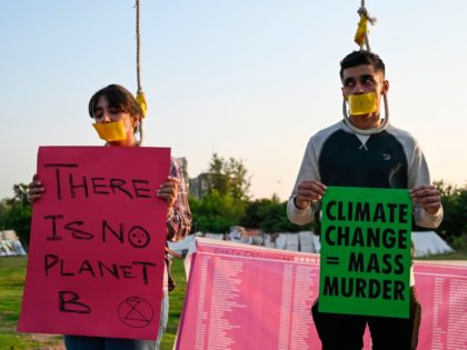 Climate activists having their lips taped hold placards as they take part in a 'Global Rebellion extinction protest' in Islamabad on October 9, 2019, as part of a planned series of protests around the world by the Extinction Rebellion movement. (Photo by Aamir QURESHI / AFP) (Photo by AAMIR QURESHI/AFP …