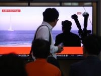 SEOUL, SOUTH KOREA - OCTOBER 02: People watch a TV showing a file image of a North Korean missile launch at the Seoul Railway Station on October 02, 2019 in Seoul, South Korea. North Korea fired what was believed to be a submarine-launched ballistic missile (SLBM) from waters off its …