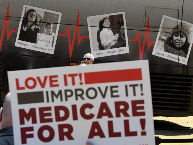 """Healthcare advocate groups and supporters protest during a rally themed, """"Our Lives On the Line: A Rally to Protect Our Healthcare,"""" to demonstrate against the attempts to repeal the Affordable Care Act, in Los Angeles, California, on July 29, 2017. / AFP PHOTO / Mark RALSTON (Photo credit should read …"""