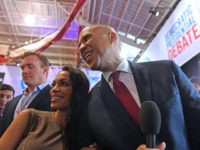 US actress Rosario Dawson (L) and boyfriend Democratic presidential hopeful New Jersey Senator Cory Booker pose for pictures in the spin room after the fourth Democratic primary debate of the 2020 presidential campaign season co-hosted by The New York Times and CNN at Otterbein University in Westerville, Ohio on October …