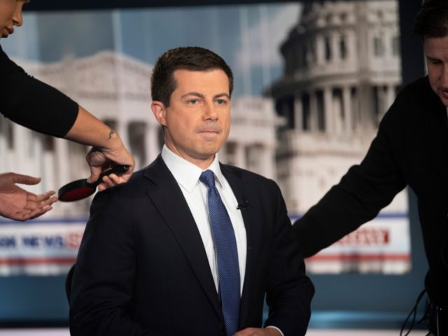 Democratic presidential candidate South Bend Mayor Pete Buttigieg prepares for an interview by FOX News Sunday anchor Chris Wallace, Sunday morning, Oct. 20, 2019, in Washington. (AP Photo/Kevin Wolf)