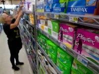 FILE - In this June 22, 2016 file photo, Tammy Compton restocks tampons at Compton's Market, in Sacramento, Calif. Bills to exempt feminine hygiene products and diapers from sales taxes were vetoed by Gov. Jerry Brown in 2016, but the measure's author's Assemblywomen Lorena Gonzalez Fletcher, D-San Diego, and Cristina …