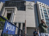 People walk by police barriers next to Istanbul's courthouse on September 18, 2019, during the trial of a US consulate staffer accused of spying and attempting to overthrow the government, in Istanbul. - A Turkish court ruled on September 18, 2019, that a US consular staffer would remain in jail …
