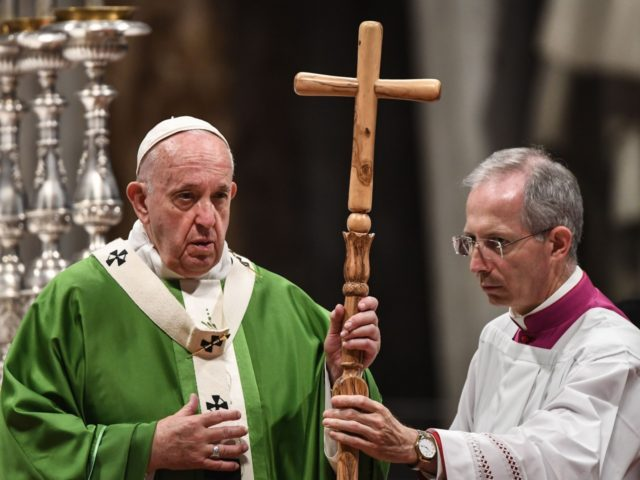 Master of Pontifical Liturgical ceremonies, Italian priest Guido Marini (R) hands a crucifix to Pope Francis during a mass as part of World Mission Sunday on October 20, 2019 at St. Peter's Basilica in the Vatican. (Photo by Vincenzo PINTO / AFP) (Photo by VINCENZO PINTO/AFP via Getty Images)