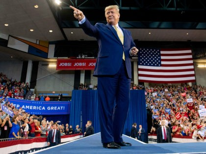 """US President Donald Trump gestures as he arrives for a """"Keep America Great"""" rally at Sudduth Coliseum at the Lake Charles Civic Center in Lake Charles, Louisiana, on October 11, 2019. (Photo by SAUL LOEB / AFP) (Photo by SAUL LOEB/AFP via Getty Images)"""