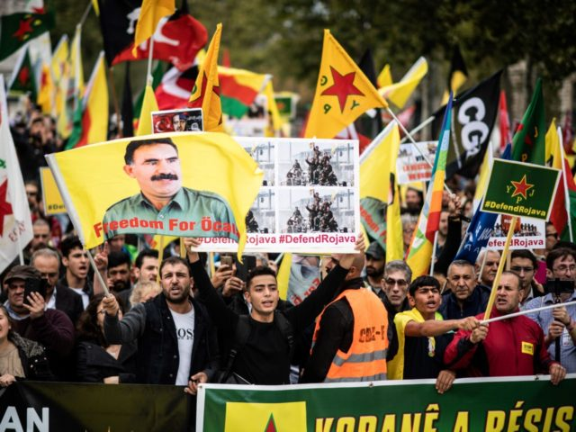 People hold pro-Kurd flags and banner in Paris on October 12, 2019 during a demonstration to support Kurdish militants and protest as Turkey kept up its assault on Kurdish-held border towns in northeastern Syria, on the fourth day of an offensive that is drawing growing international condemnation, even from Washington. …