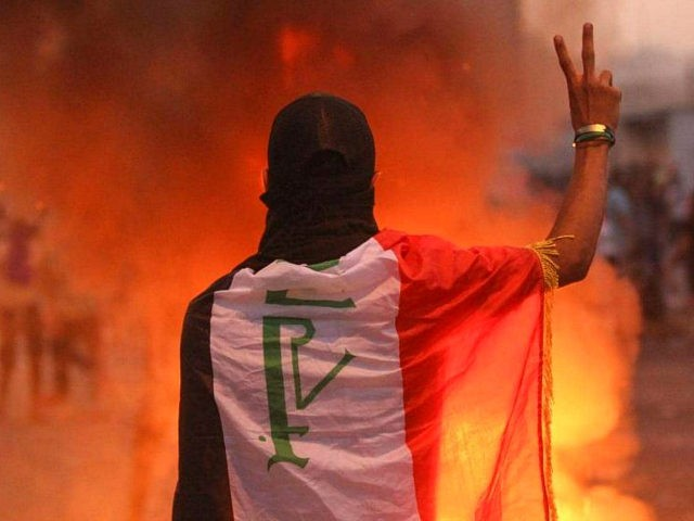 TOPSHOT - An Iraqi protester gestures the v-sign during a demonstration against state corruption, failing public services and unemployment at Tayaran square in Baghdad on October 2, 2019. - Iraq's president and the United Nations urged security forces to show restraint after two protesters were killed in clashes with police …