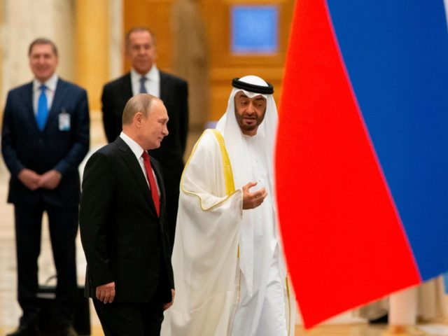 Russian President Vladimir Putin and Abu Dhabi Crown Prince Mohammed bin Zayed al-Nahyan attend the official welcome ceremony in Abu Dhabi, United Arab Emirates, on October 15, 2019. (Photo by Alexander Zemlianichenko / POOL / AFP) (Photo by ALEXANDER ZEMLIANICHENKO/POOL/AFP via Getty Images)