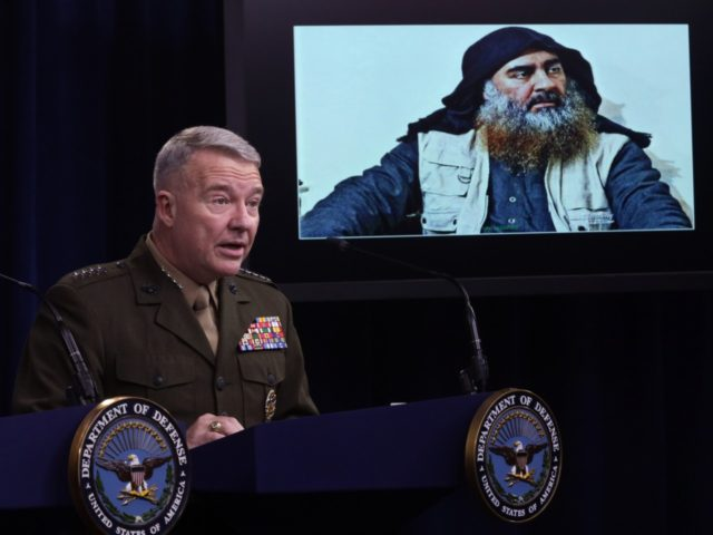 ARLINGTON, VIRGINIA - OCTOBER 30: U.S. Marine Corps Gen. Kenneth McKenzie, commander of U.S. Central Command, speaks as a picture of Abu Bakr al-Baghdadi is seen during a press briefing October 30, 2019 at the Pentagon in Arlington, Virginia. Gen. McKenzie and Hoffman spoke to the media to provide an …