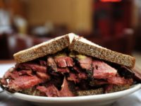 NEW YORK, NY - MARCH 20: A classic pastrami sandwich is viewed at Katz's Delicatessen on March 20, 2015 in New York City. A pastrami sandwich at Katz's will now cost $21.50 with tax due to the rise in the meats price. Beef prices increased 19% in January and are …