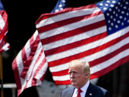 """TOPSHOT - US President Donald Trump leaves after the """"Celebration of America"""" at the White House in Washington, DC, on June 5, 2018. - Trump's """"The Celebration of America"""" honors football fans and not the NFL champions Philadelphia Eagles after he reignited his feud with the league by abruptly canceling …"""