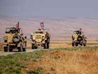 A convoy of US military vehicles drives through the Syrian northeastern town of Qahtaniyah on the border with Turkey on October 31, 2019. - US forces patrolled part of Syria's border with Turkey today in the first such move since Washington withdrew troops from the area earlier this month, an …