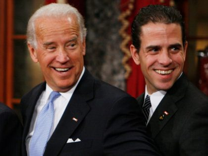 Vice President-elect, Sen. Joe Biden, D-Del., left, stands with his son Hunter during a re-enactment of the Senate oath ceremony, Tuesday, Jan. 6, 2009, in the Old Senate Chamber on Capitol Hill in Washington. (AP Photo/Charles Dharapak)