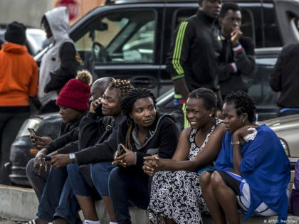 A group of migrants, mostly from African countries, wait to request an appointment with US migration authorities outside El Chaparral port of entry, in Tijuana, Baja California state, Mexico, on July 17, 2019. (Photo by OMAR MARTÍNEZ / AFP) (Photo credit should read OMAR MARTINEZ/AFP/Getty Images)