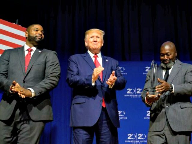 President Donald Trump (C) is awarded the Bipartisan Justice Award by Matthew Charles (R), who was released from federal prison through the First Step Act, prior to delivering remarks at the 2019 Second Step Presidential Justice Forum in Columbia, South Carolina on Oct. 25, 2019. (Jim Watson/AFP via Getty Images) …